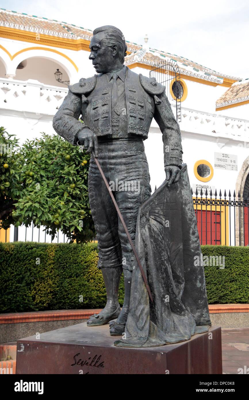 Statue of Matador Curro Romero, Plaza de Toros de la Real Maestranza de Caballería de Sevilla (bull ring), Seville, Spain. - Stock Image