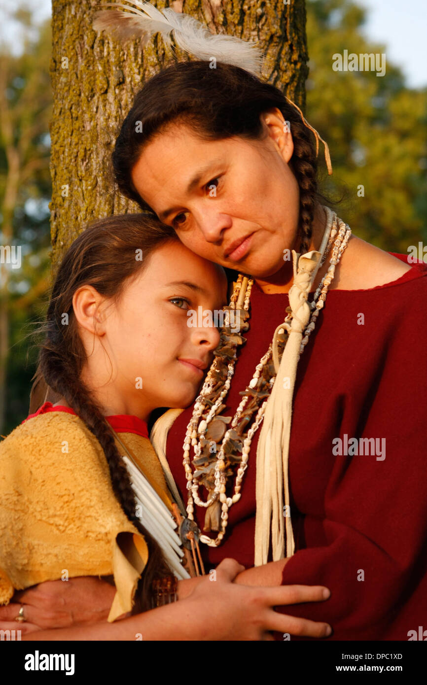 An Native American Lakota Sioux Indian mother hugging her son - Stock Image