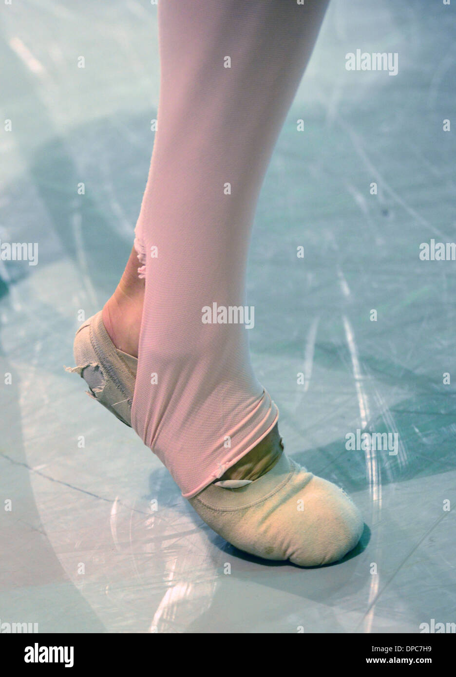 ballet dancer foot with worn out shoes - Stock Image