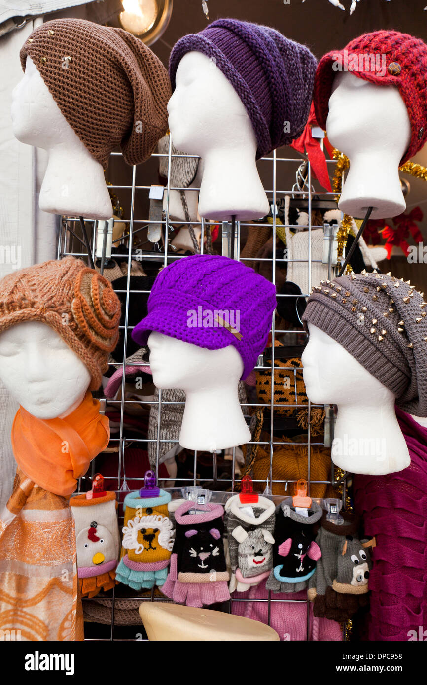 Womens knit hats on display - Stock Image