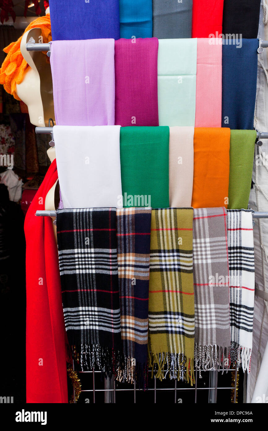 Various colors of wool scarves on display at clothing store - USA - Stock Image