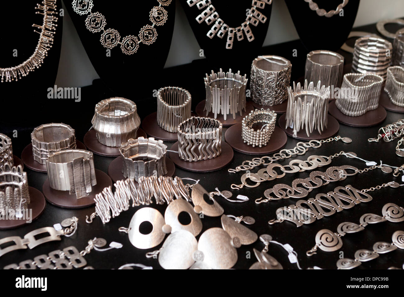 Womens stainless steel cuff bracelets on display - Stock Image