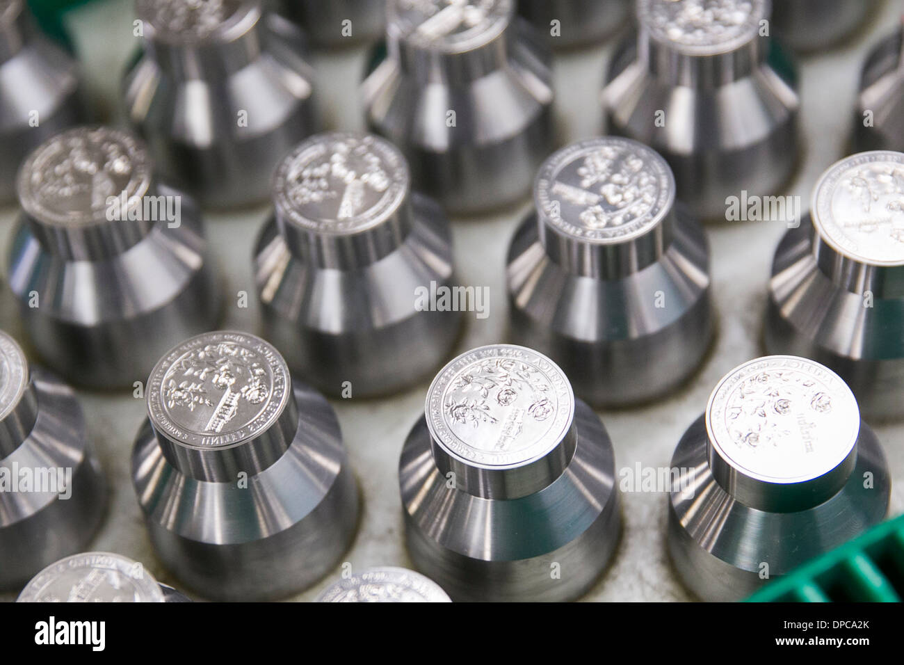 Quarter coin die manufacturing at the Philadelphia branch of the United States Mint.  Stock Photo