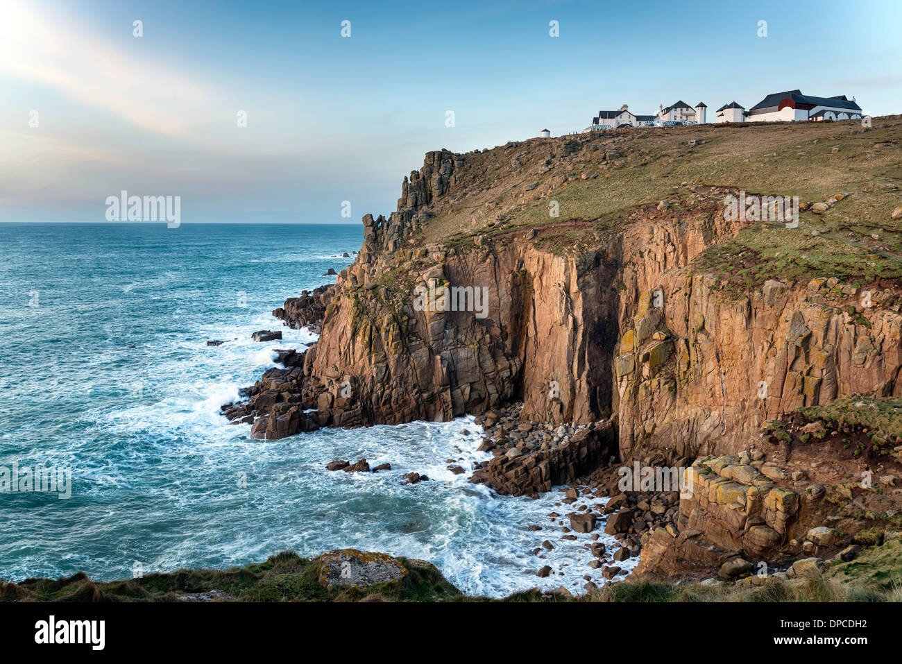 Sea and steep rugged cliffs at Lands End in Cornwall - Stock Image