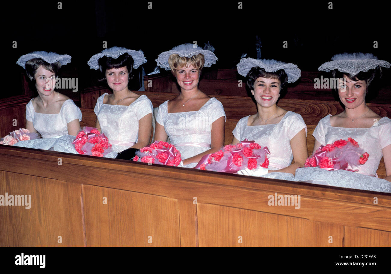 65538063134 Five smiling bridesmaids in matching white dresses and frilly hats ...