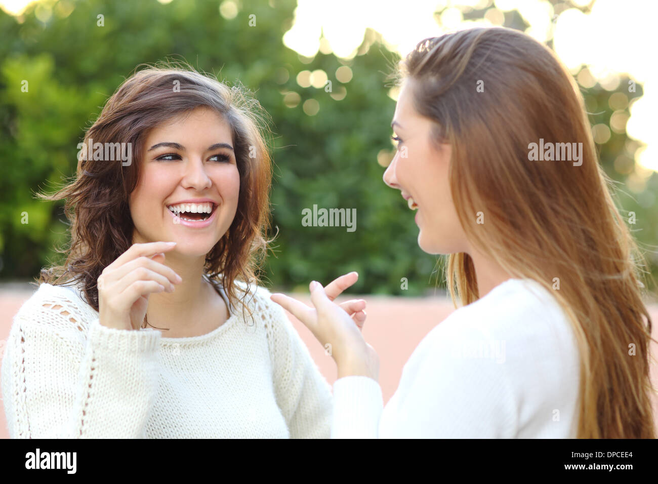 Two young women talking happy outdoor - Stock Image