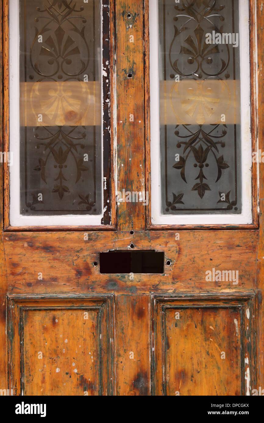 Glazed Wooden Front Door Under Restoration Renovation Repair