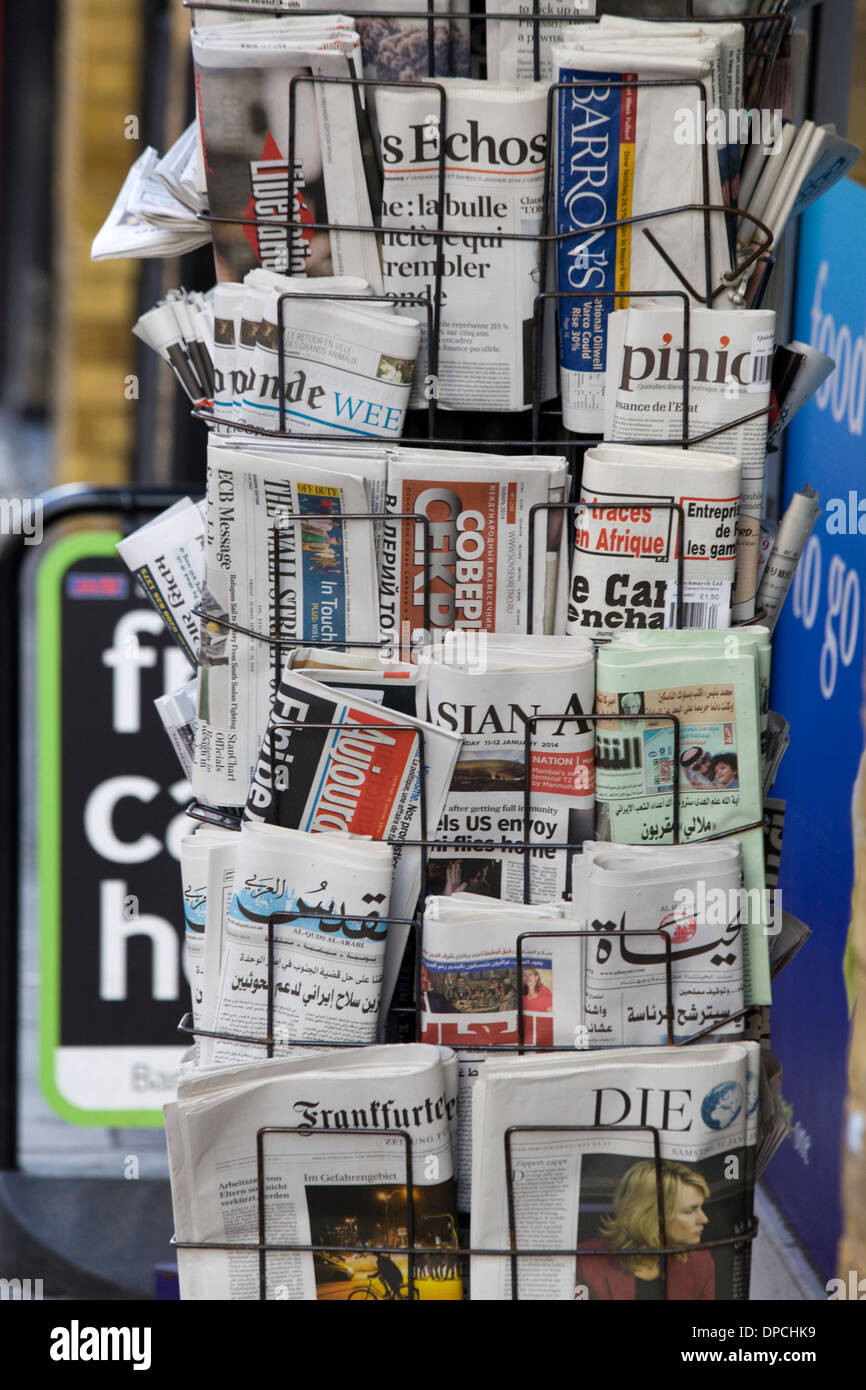 International Newspapers on a stand - Stock Image