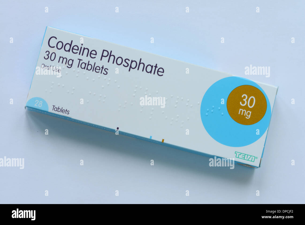 Codeine Phosphate tablets on a pale blue background - Stock Image