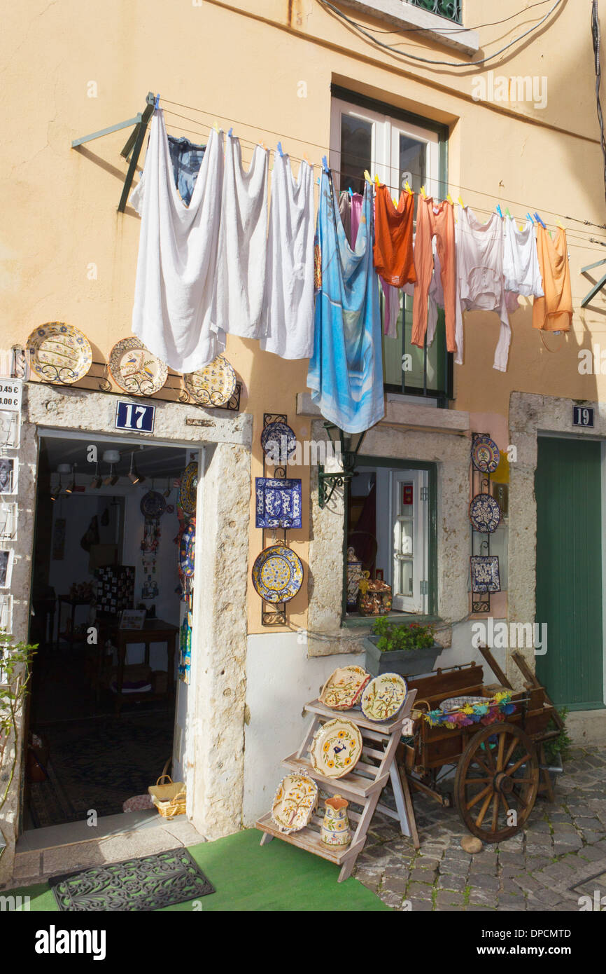 Alfama District, Lisbon, Portugal. Shop selling pottery and souvenirs. - Stock Image
