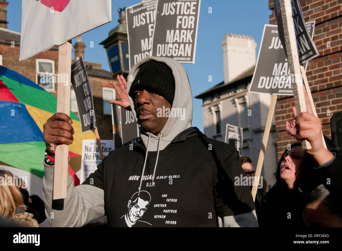 Family & friends at Vigil for Mark Duggan killed in 2011 by police officer following inquest judgement of lawful killing 11.1.14 - Stock Image