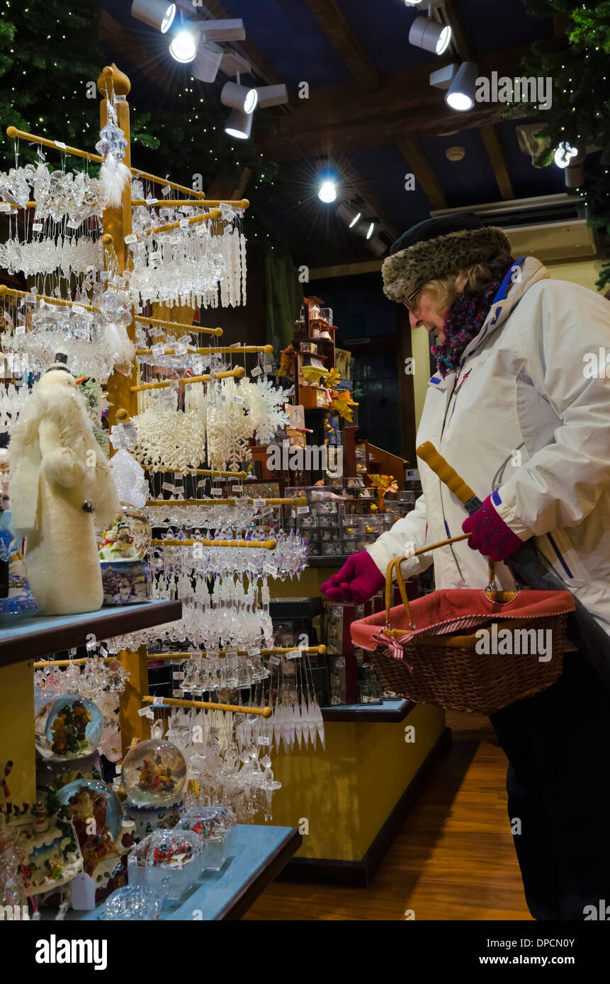 Belgium Brugge older woman shopping for Christmas decorations - Stock Image