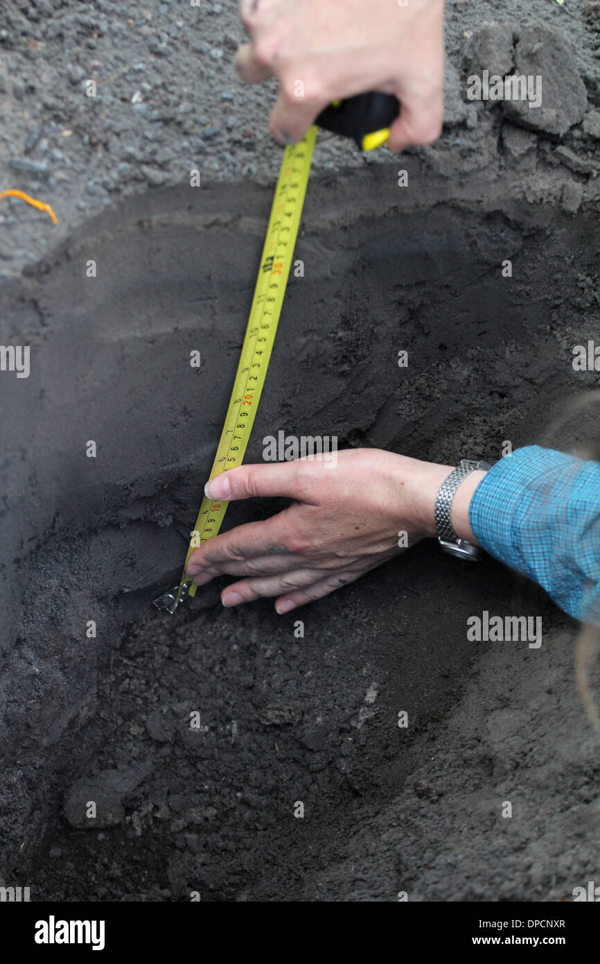 measuring ash near Mt Merapi Indonesia volcano - Stock Image