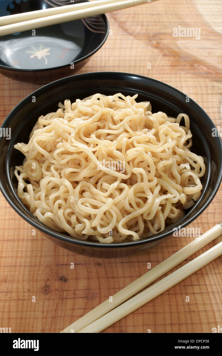 Ramen instant noodles in lacquer bowls with chopsticks - Stock Image