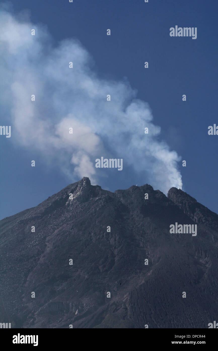 Mt Merapi smoking summit Indonesia volcano - Stock Image