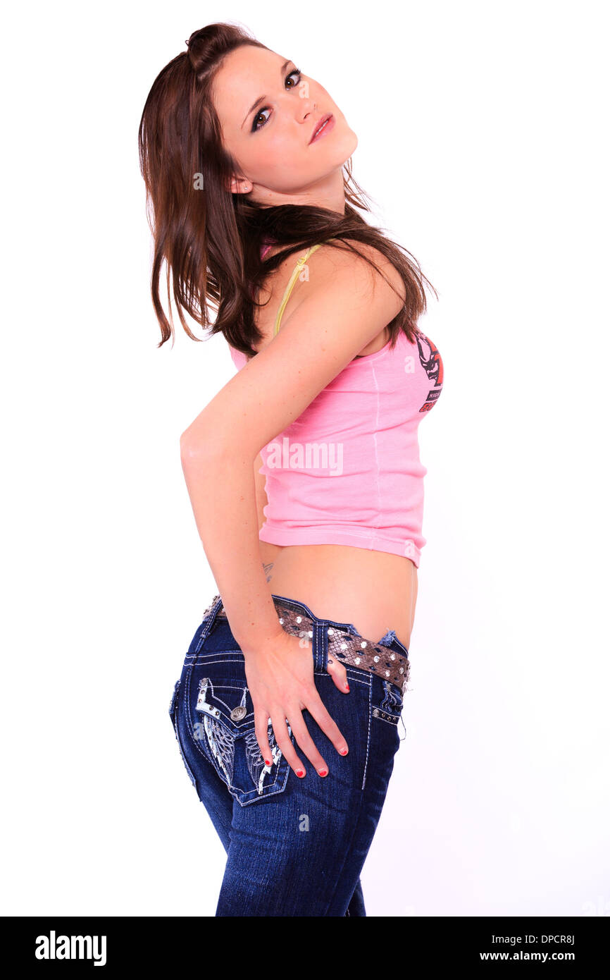 c06675829ded7 Portrait of a casual young woman in midriff shirt and jeans. - Stock Image