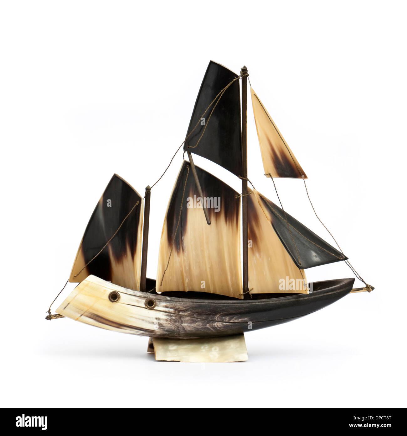 Vintage model sailing ship, handmade from bone or horn - Stock Image