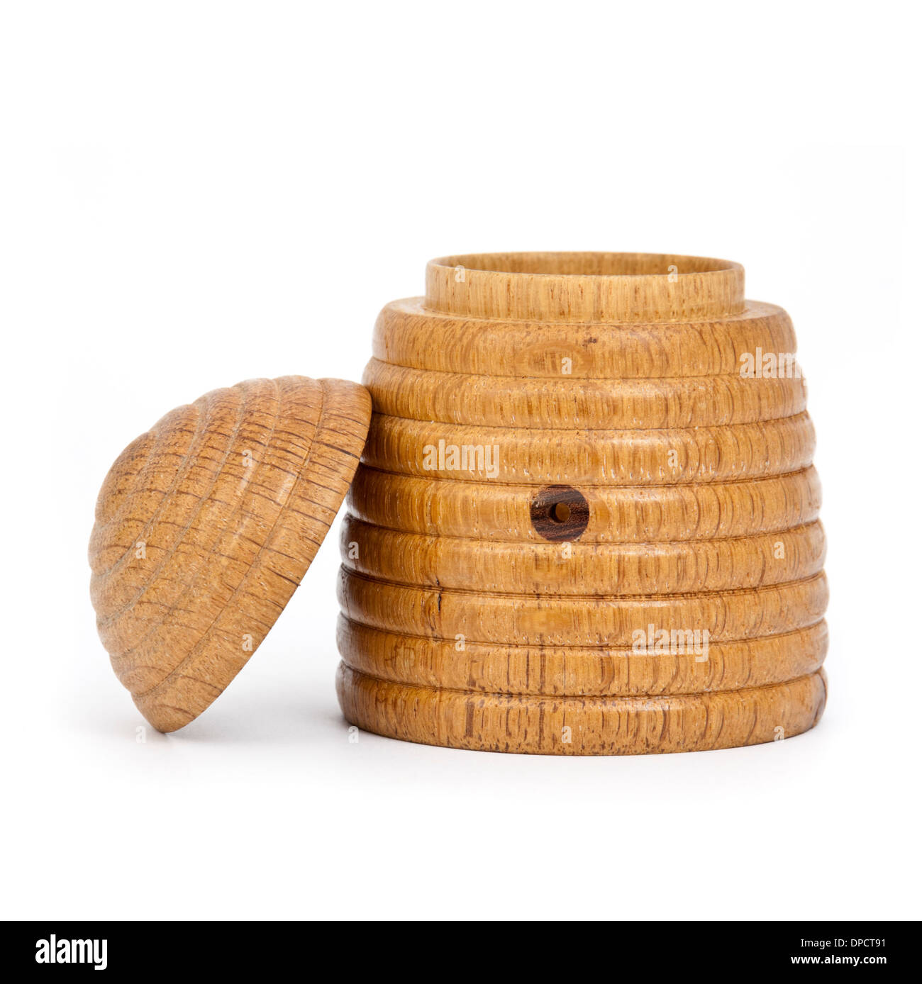 Vintage wooden beehive-shaped honey pot - Stock Image