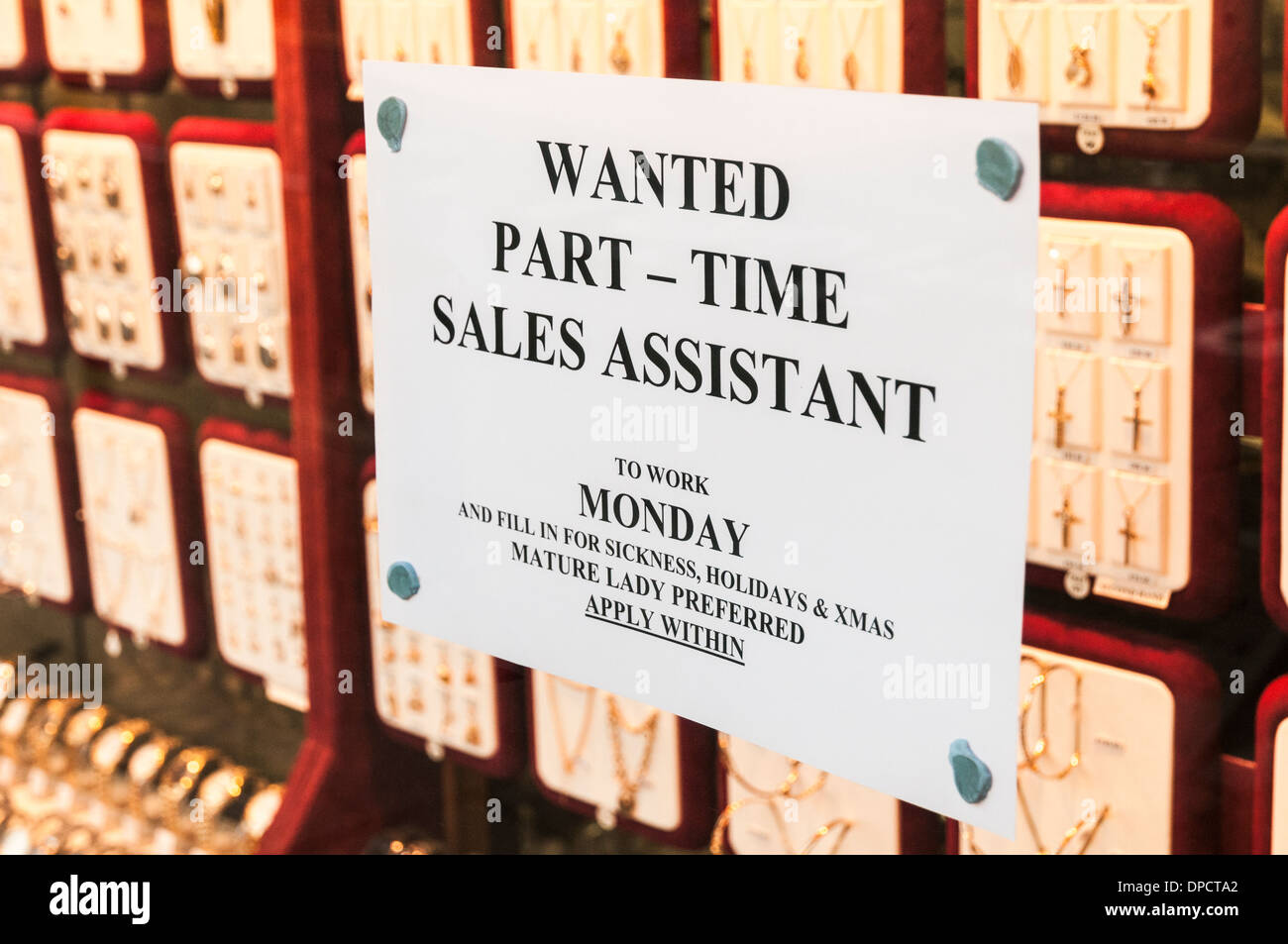 Job advertisement in a jewellers shop window advertising for a part time sales assistant - Stock Image