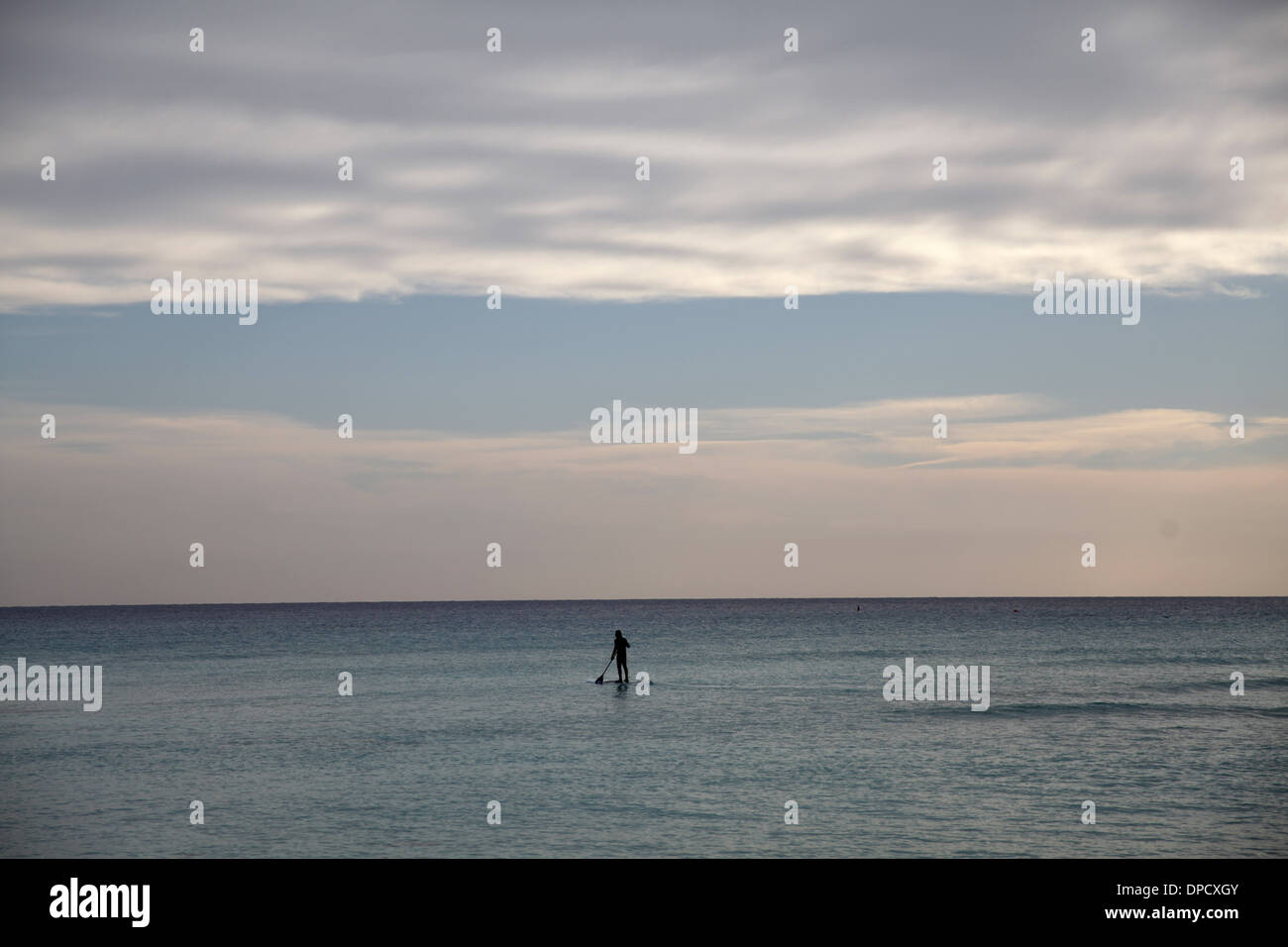 A surfer paddles in Nissi beach in Ayia Napa,Cyprus on January 9,2014 Stock Photo
