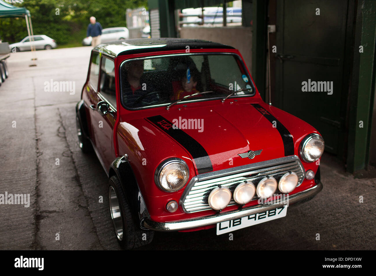 A classic racing red Mini Cooper 1275 GT car at a rural country fair and  rally in Northern Ireland