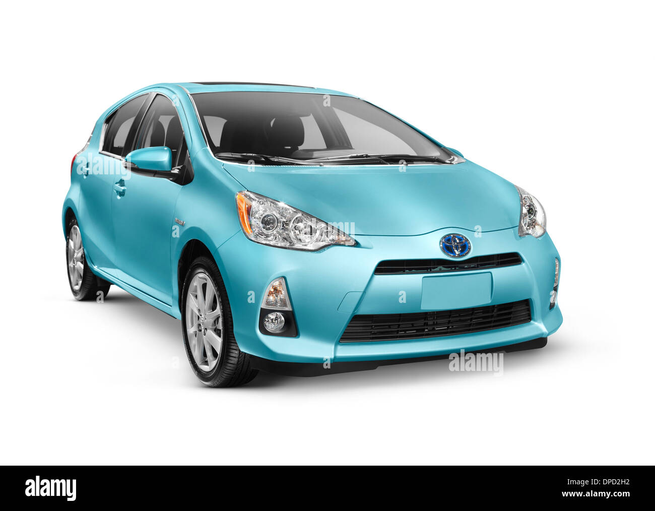Blue 2013 Toyota Prius C mid-size hybrid car isolated on white background with clipping path - Stock Image