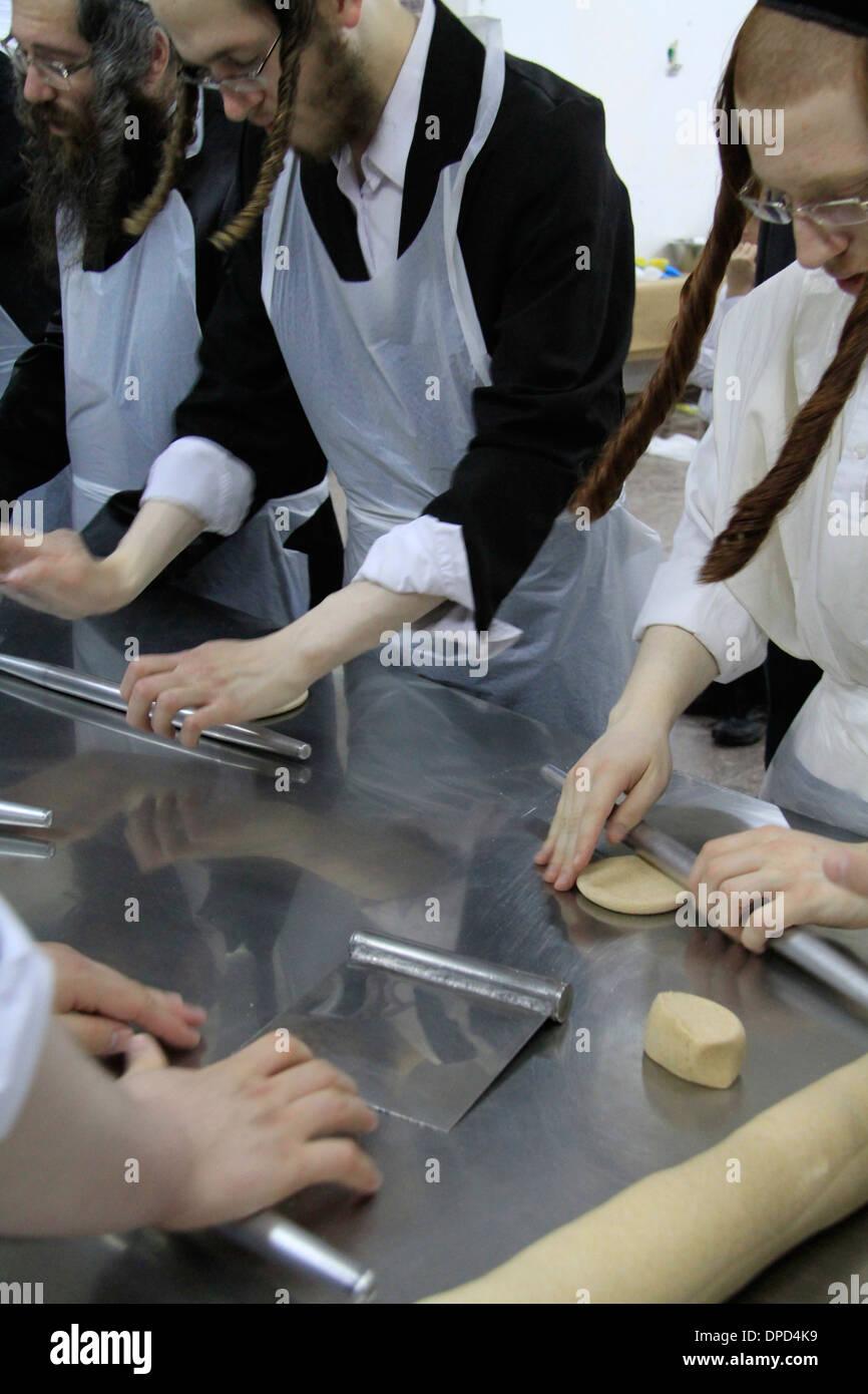 Matzah baking ahead of the Seder meal at the Hasidic Premishlan congrgation, preparation of the dough - Stock Image