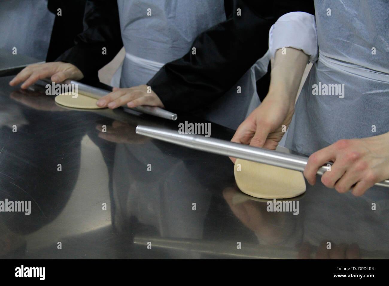 Matzah making ahead of the Seder meal at the Hasidic Premishlan congrgation, preparation of the dough - Stock Image