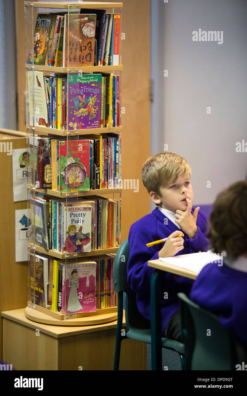 A primary school pupil in a literacy class in the UK - Stock Image
