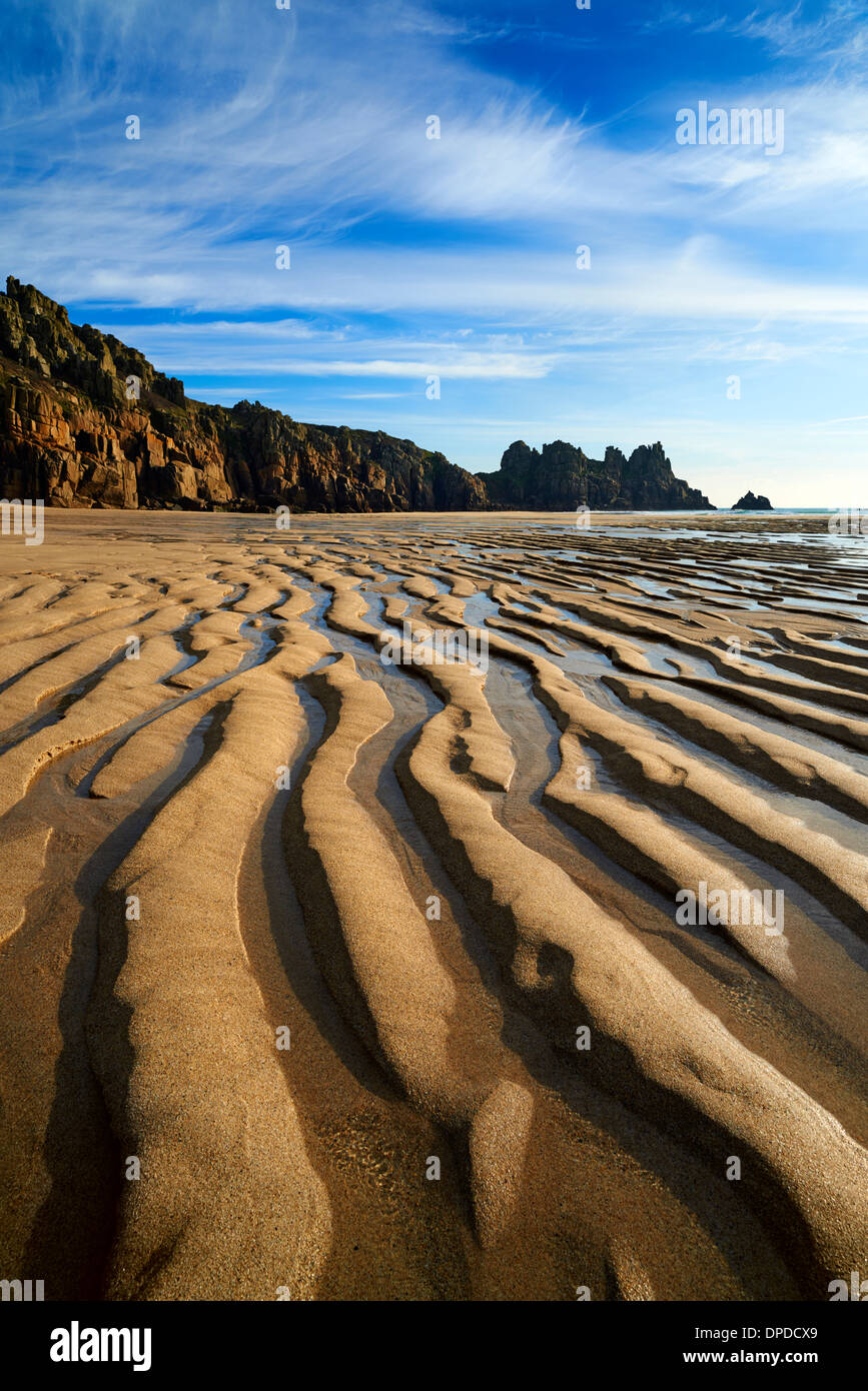 Low tide at Pednvounder beach, large ripples of sand created wave motion - Stock Image
