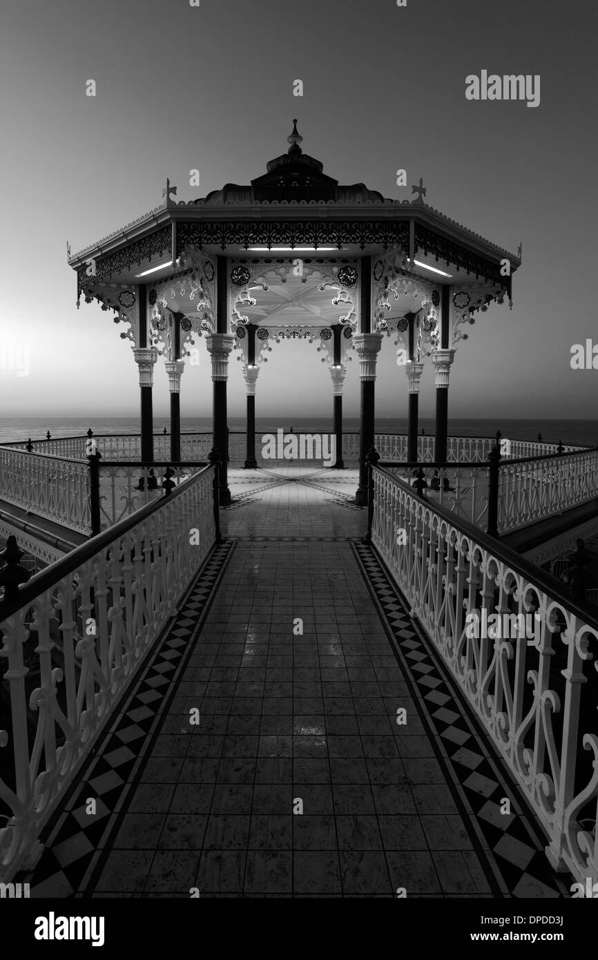Dawn colours over the Victorian Bandstand, seaside promenade, Brighton City, Brighton & Hove, Sussex, England, UK - Stock Image