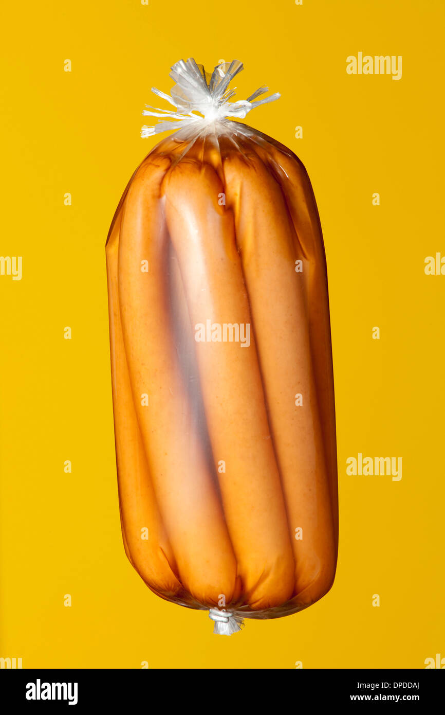 Conserved sausages in transparent plastic wrapping Stock Photo