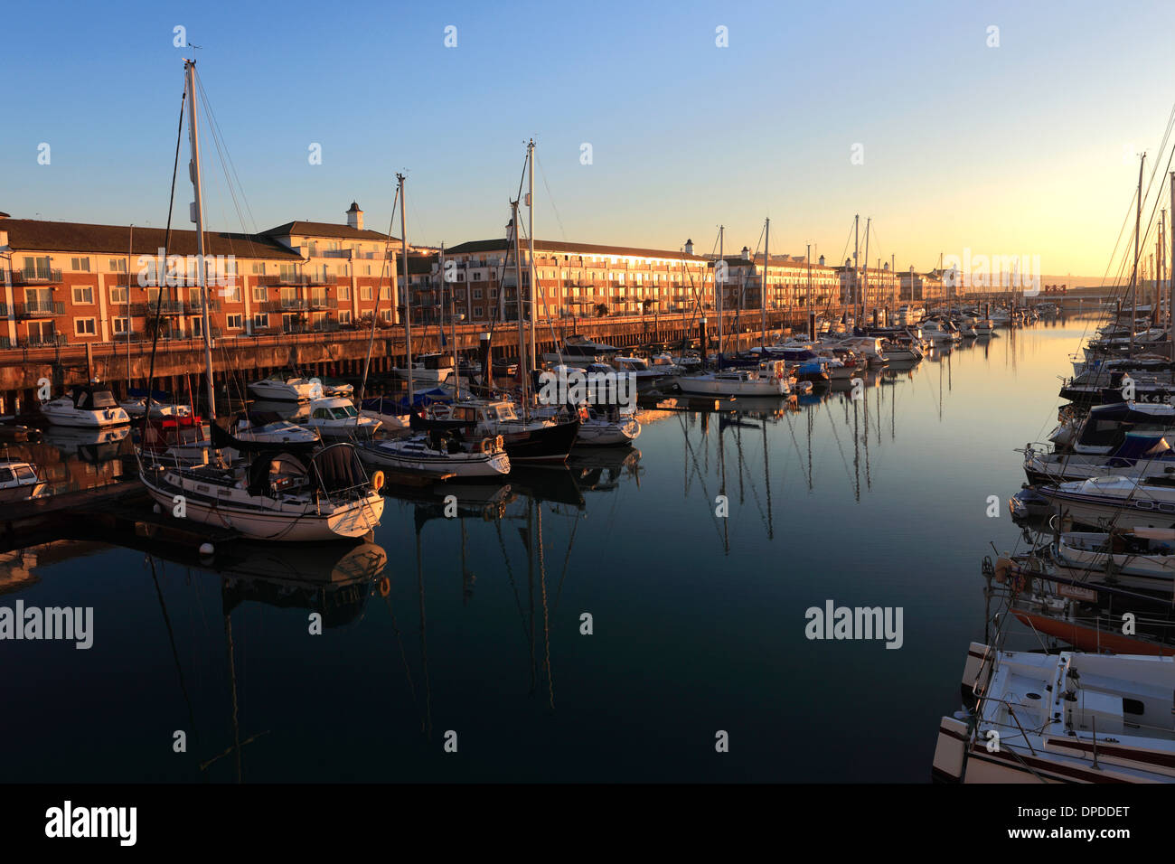 Dawn, boats and houses in Brighton Marina, Brighton & Hove, Sussex County, England, UK - Stock Image