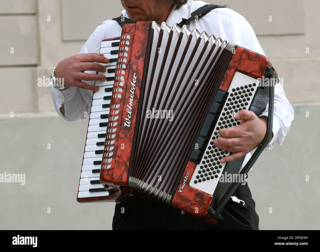 Accordion player in a street in the historic center of Prague. Czech Republic. - Stock Image