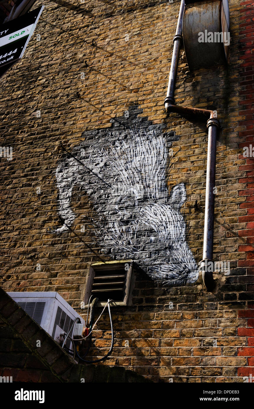 Urban street spray can wall painted art of a giant rat, Brick Lane area, East London E1 UK Stock Photo