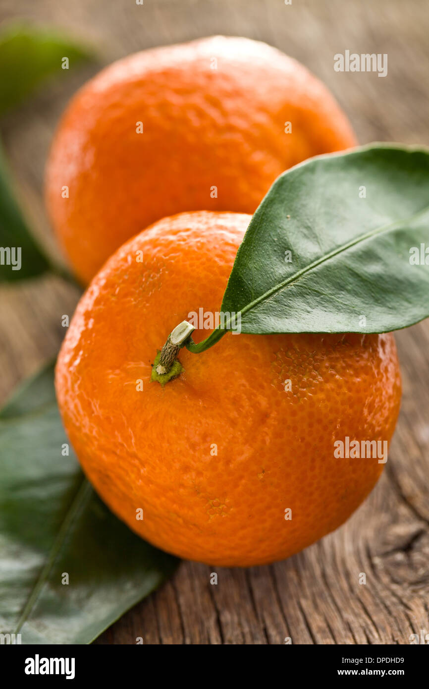 fresh mandarin on wooden background - Stock Image