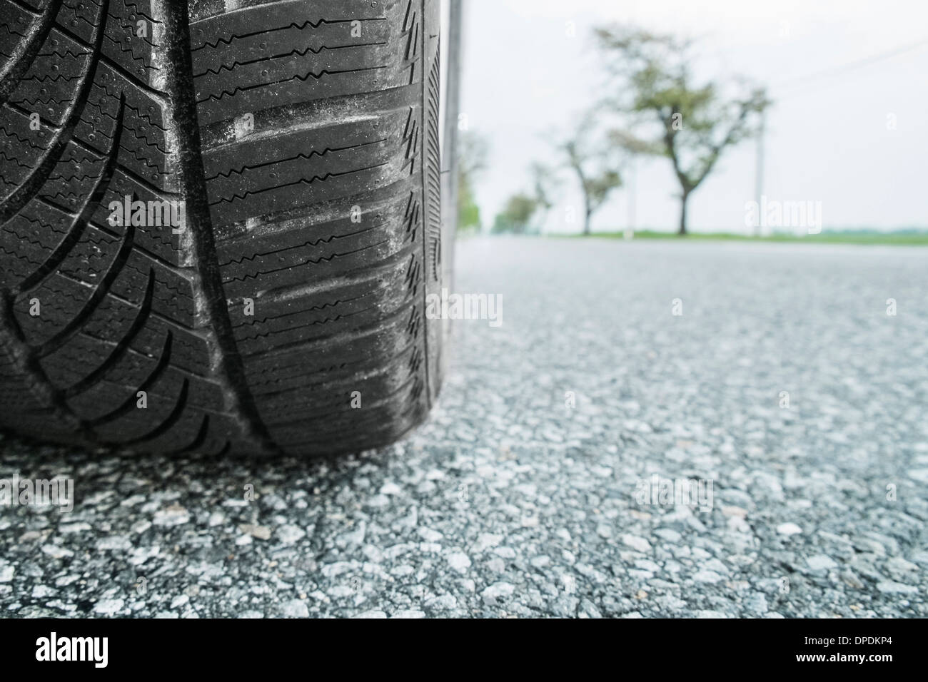 Car tire on road, close up - Stock Image
