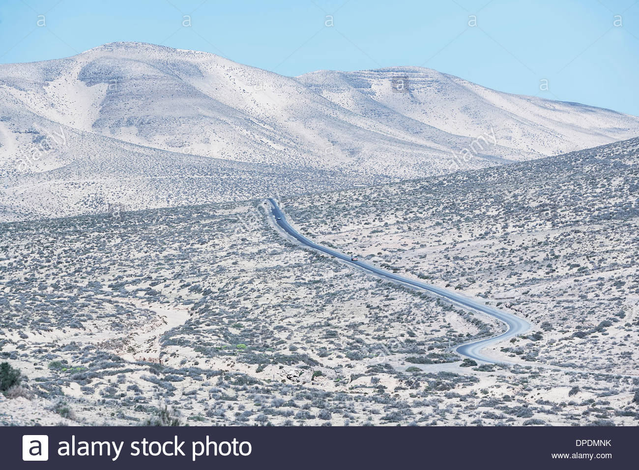 Road winding through Fuerteventura landscape, Canary Islands, Spain - Stock Image
