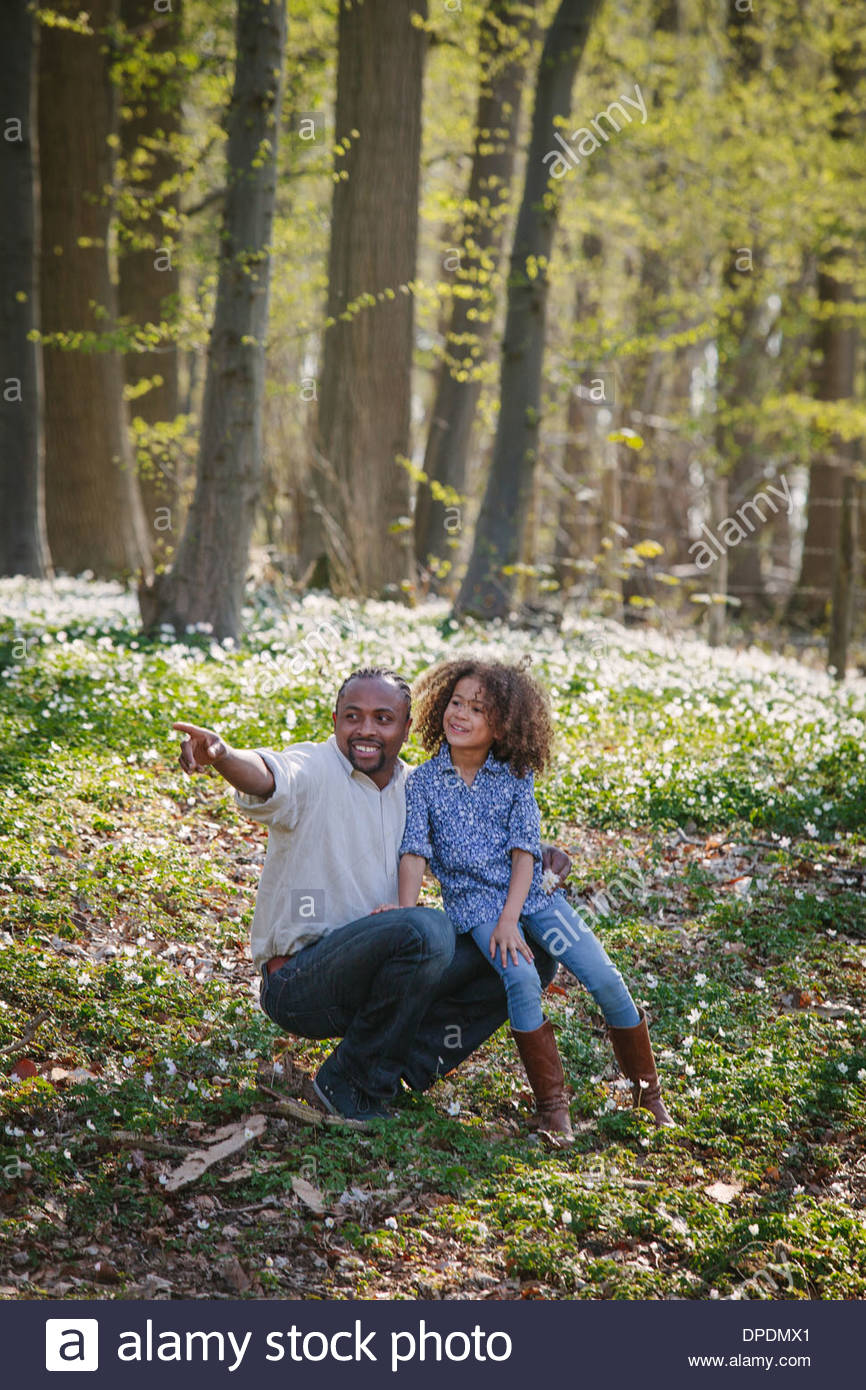 Young girl and father in woods Stock Photo
