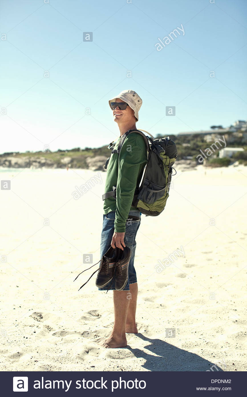 Young man on beach, Cape Town, South Africa - Stock Image