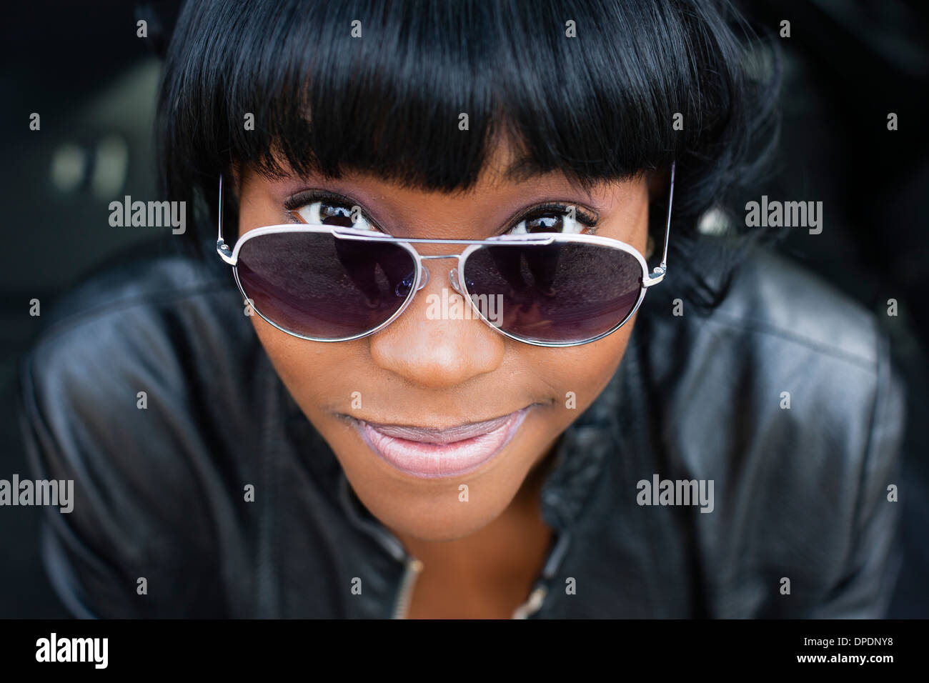 Close up portrait of young woman in sunglasses Stock Photo