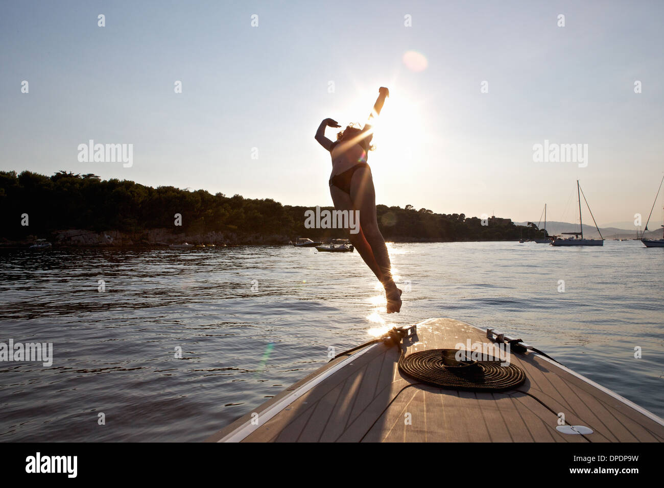 Woman diving from boat, Cannes Islands, Cote D'Azur, France - Stock Image