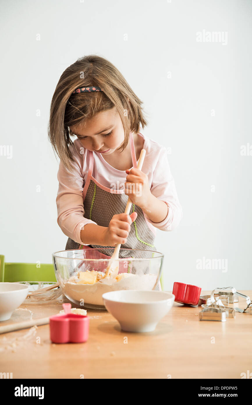Girl mixing batter in bowl Stock Photo