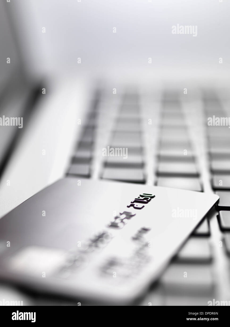 Credit card on laptop to illustrate internet shopping and internet fraud Stock Photo