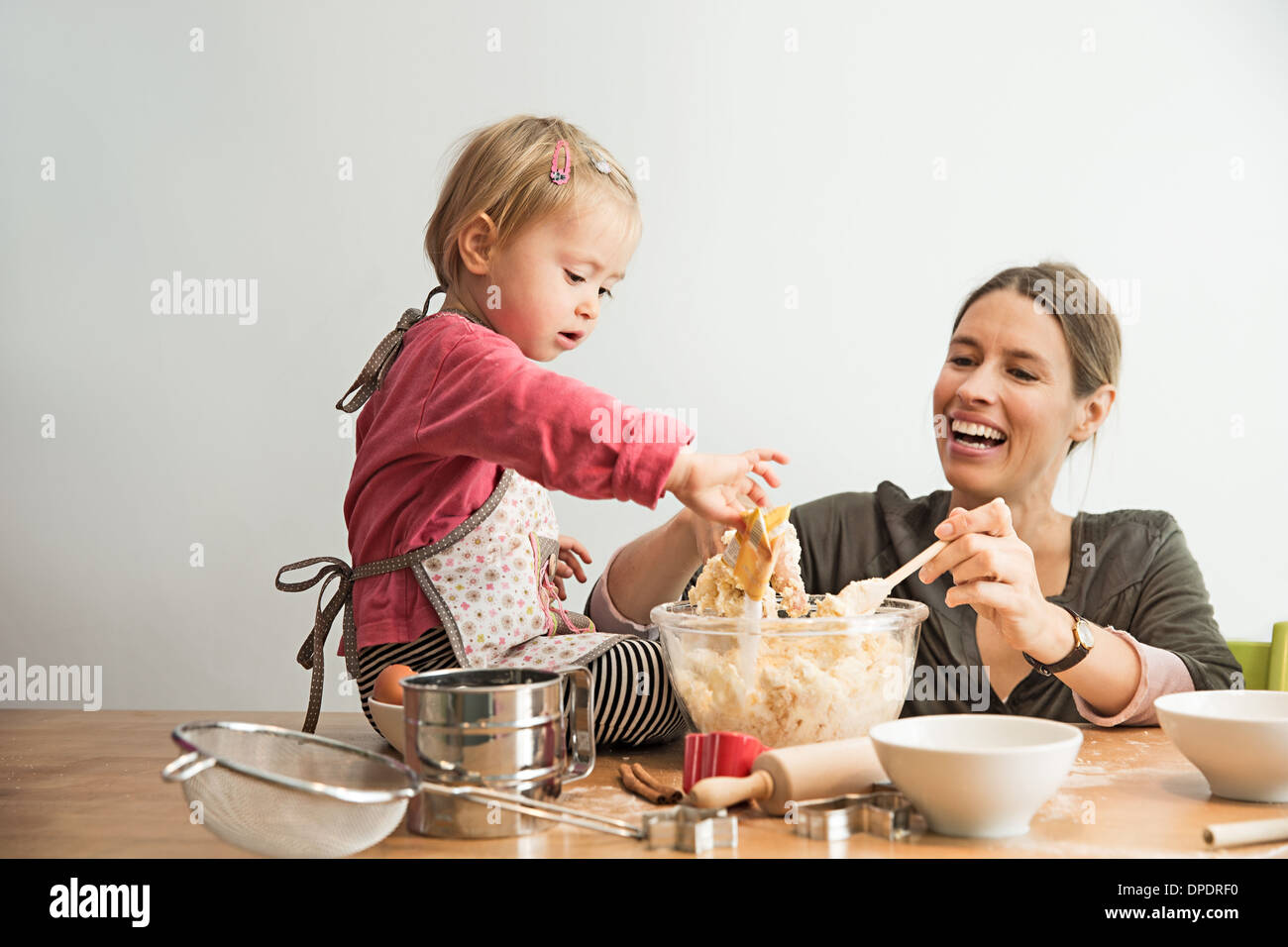 Mother and child mixing batter Stock Photo