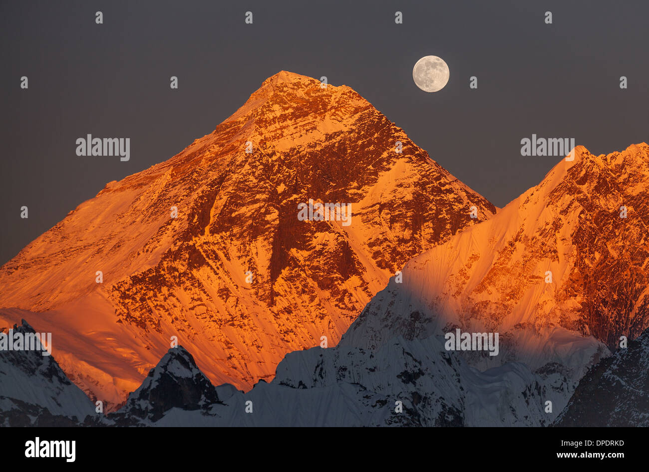 Majesty of nature. Golden pyramid of Mount Everest (8,848 m) at sunset on a full moon. Canon 5D Mk II. - Stock Image