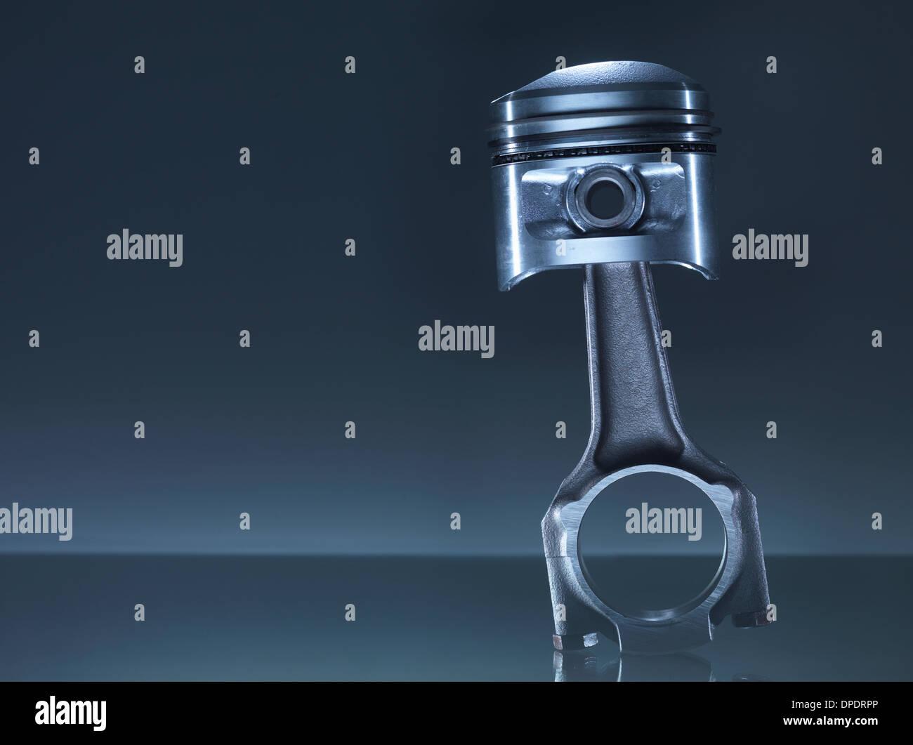 Car engine piston on grey background - Stock Image