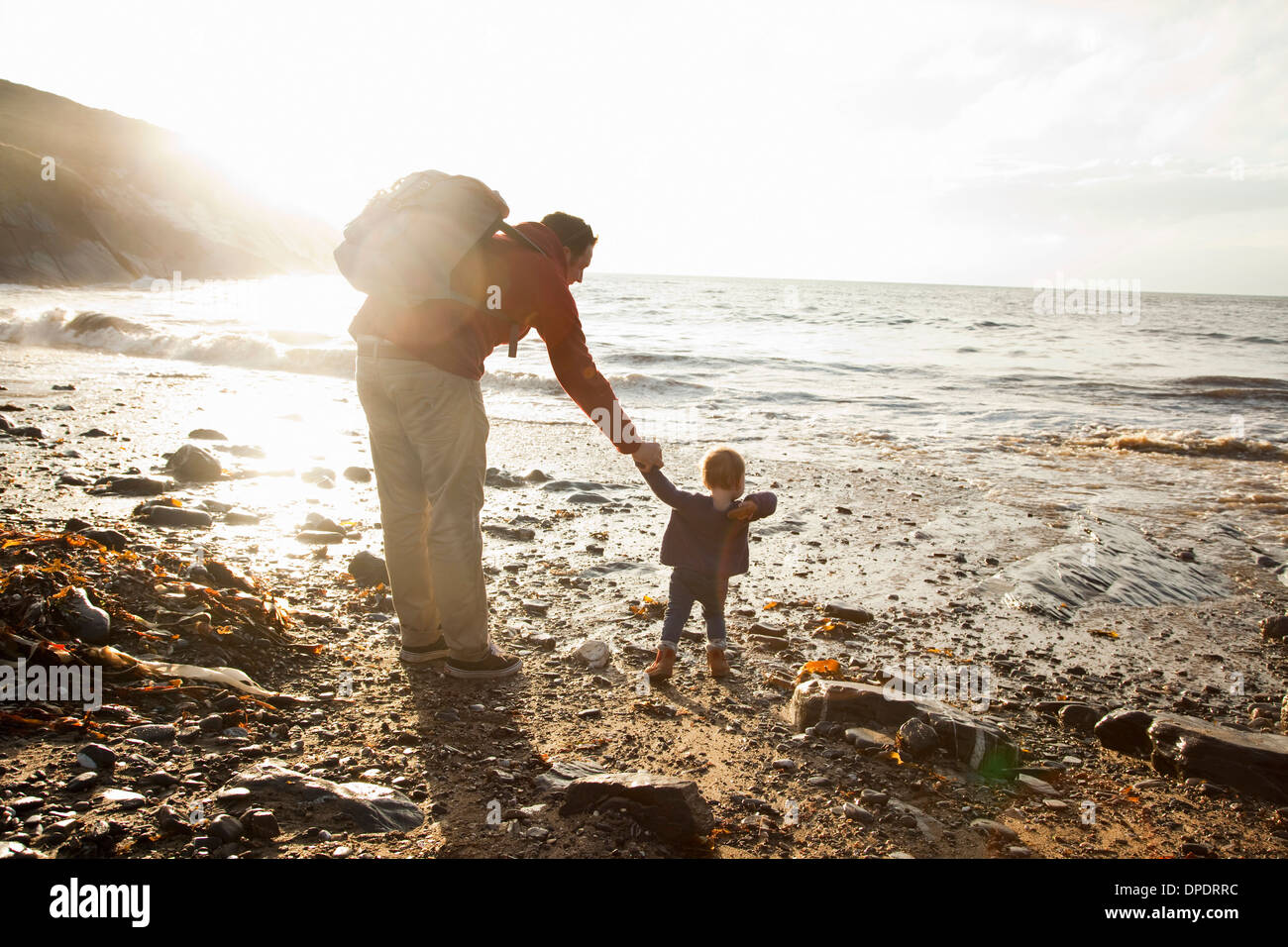 Father and child enjoying beach - Stock Image
