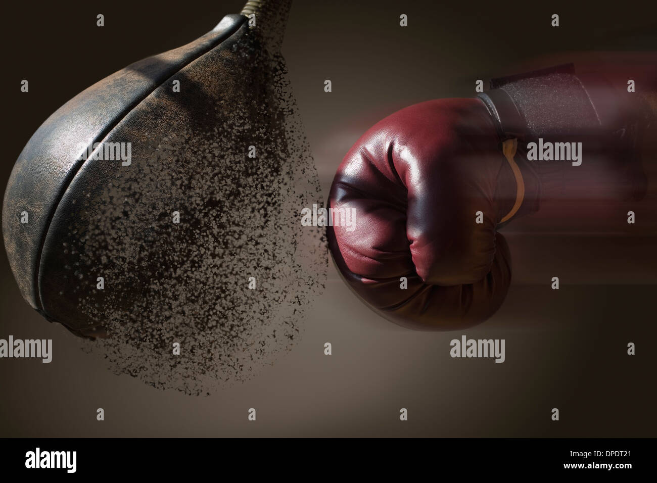 Close up boxer and punch bag with blurred motion - Stock Image