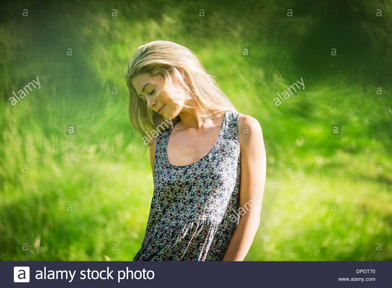 Young woman wearing sundress - Stock Image
